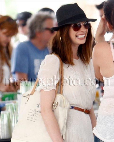 4_19_10_Anne Hathaway Summery Coachella_1.jpg